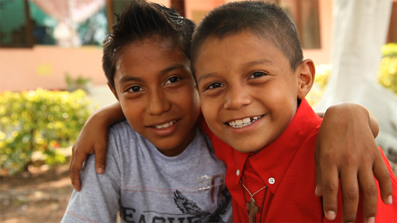Two boys who are cared for by SOS Children's Villages