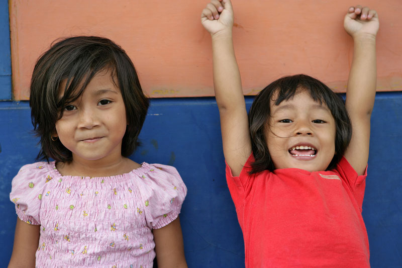 Two girls smiling in Jakarta, Indonesia