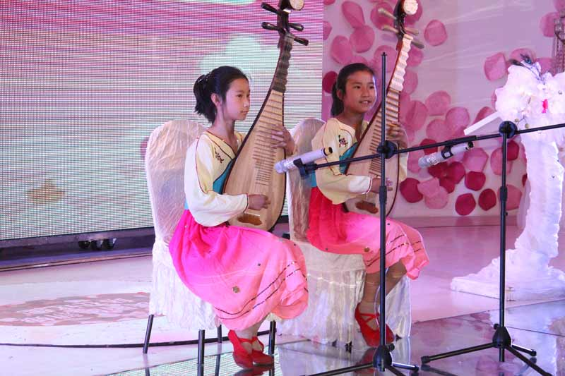 Two girls playing traditional music in Qiqihar, China