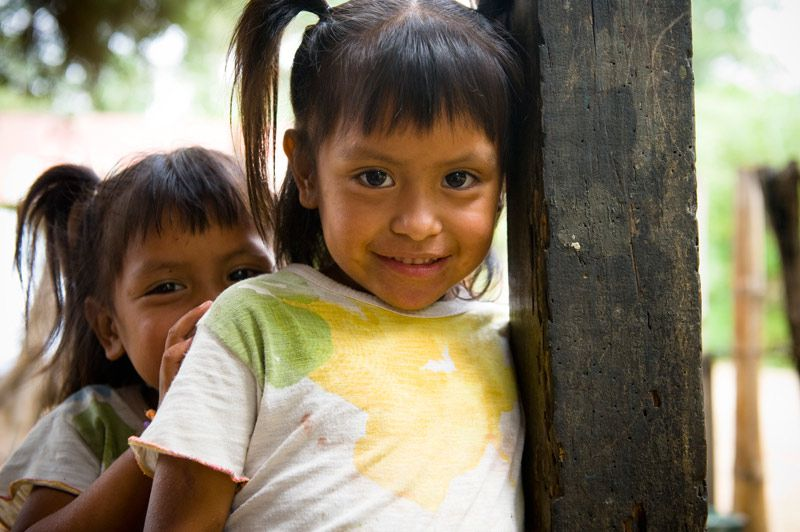 Two girls smiling in Caserio Saquille, Guatemala