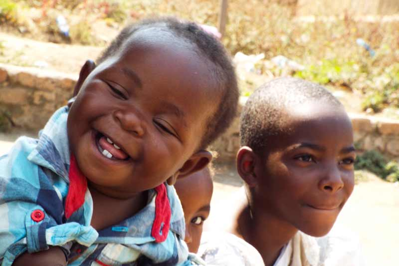 Sponsor a child in Malawi like these three children