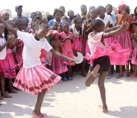 Children dancing in a welcoming dance in Ondangwa, Namibia