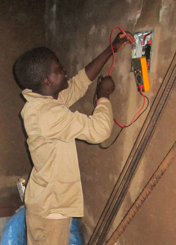 William learning to be an electrician in Malawi