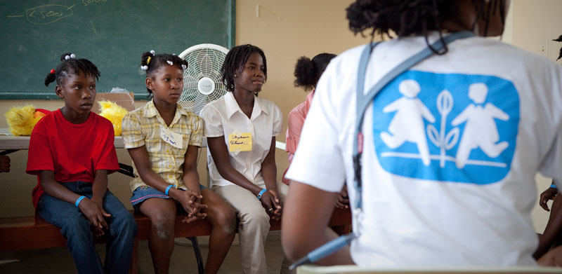 Youths and SOS co-worker/psychologist in a workshop about future after the Haiti earthquake