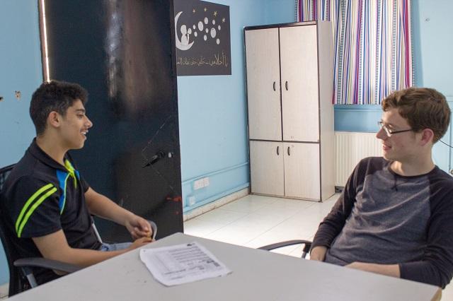 Zaki* and Jake practicing speaking English
