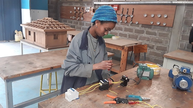 Zala working on an electrical circuit at the SOS Vocational Training Centre.